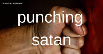 punching satan